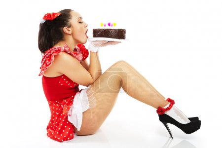 Young beautiful woman with a cake.