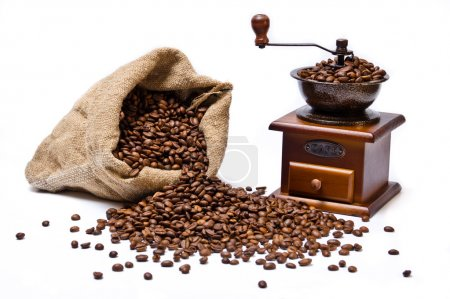 Coffee beans sack with scattered beans and wooden coffee-grinder