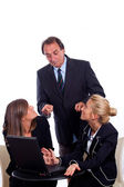 Boss angry with Two Businesswoman Chatting instead of Working