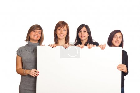 Photo for Four Beautiful Girls Holding a Blank Billboard - Royalty Free Image