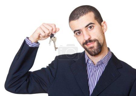 Photo pour Clé de détention de l'agent immobilier - image libre de droit