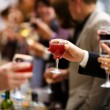 Holiday Event cheering each other with champagne a...