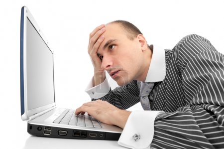 Worried businessman with computer