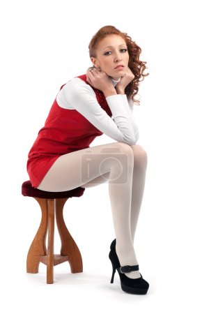 Beautiful sexy girl sitting on a chair