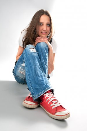 Photo for Young girl sitting on a floor - Royalty Free Image