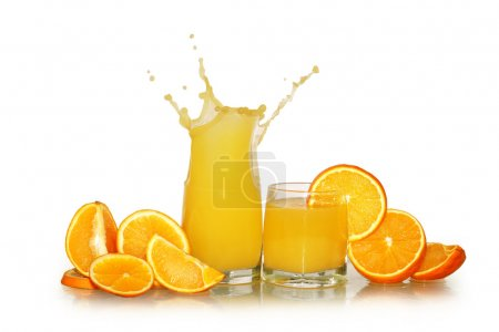 Photo for Two glasses of splashing orange juice and fruits isolated on white background with clipping path - Royalty Free Image
