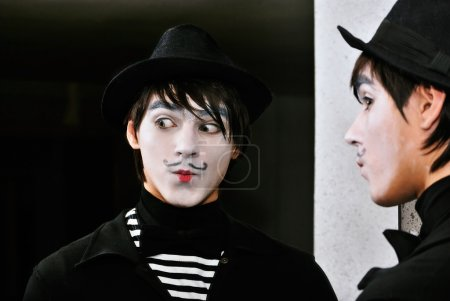 Photo for Mime actor at a mirror. Close-up - Royalty Free Image