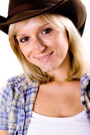 Photo pour Femme assez occidentale en chapeau de cow-boy closeup sur fond blanc - image libre de droit