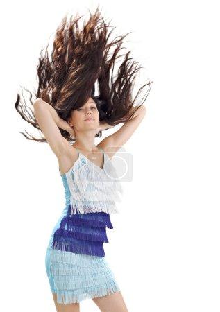 Photo pour Jeune jolie dame en robe bleue aux cheveux longs volant vers le haut portrait studio sur blanc - image libre de droit