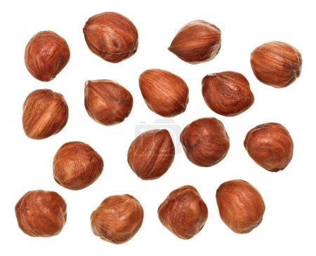 Unshelled hazel nuts isolated on white, food background