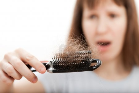 Loss hair comb in women hand