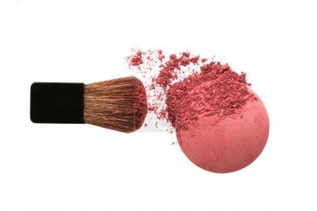 Crushed blush and brush isolated on white...