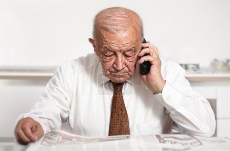 Photo for Senior caucasian man use mobile portrait - Royalty Free Image