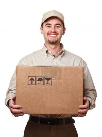Photo for Smiling delivery man holding a big parcel isolated on white - Royalty Free Image