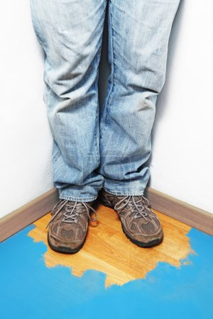 Photo for Detail of body man in a room corner with partial painting floor - Royalty Free Image