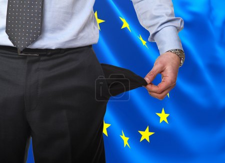 Photo for Man show empty pocket with europe flag background - Royalty Free Image