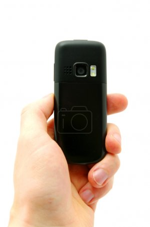 Foto de Teléfono móvil en mano aislado en blanco - Imagen libre de derechos