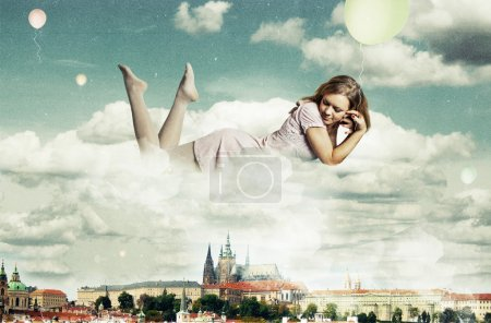 Photo for Beauty woman in the clouds over Prague - Royalty Free Image