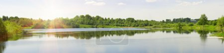 Panorama of a summer landscape with the river and ...