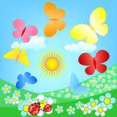 Butterflies roundelay over spring flowering meadow