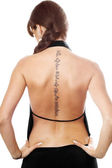 Young woman with a tattoo on her back