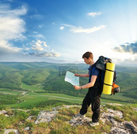 Photo for Man tourist in mountain read the map. Leisure activity. - Royalty Free Image