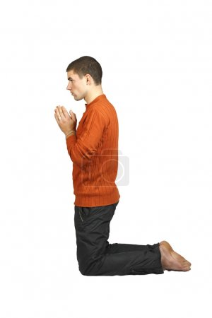 A man praying on his knees