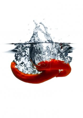 Red hot chili peppers dropped into water