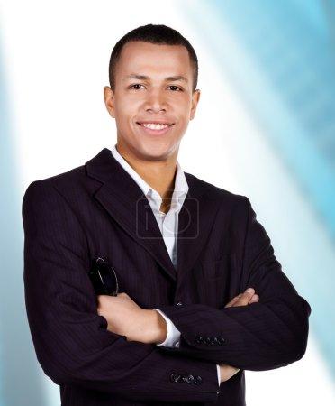 Photo pour Jeune homme d'affaires prospère sur un fond blanc - image libre de droit