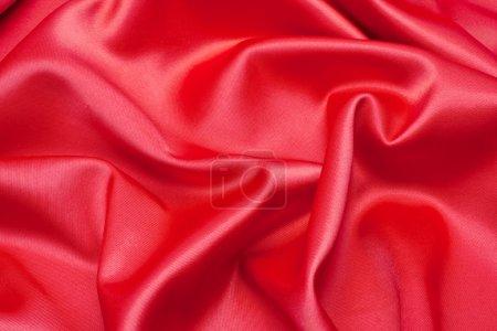 Photo pour Tissu satin rouge comme fond - image libre de droit