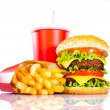 Tasty hamburger and french fries on a white backgr...