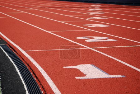 Photo for Running track at the stadium of the modern coating numbered. - Royalty Free Image
