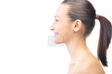 Happy smiling beautiful young woman is looking sideways isolated