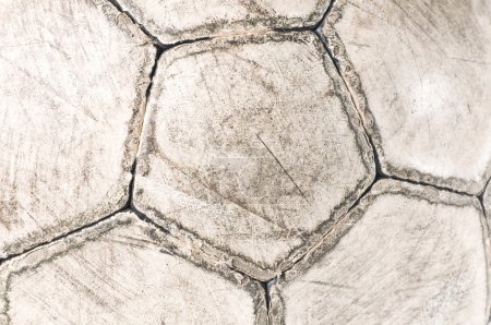Old used soccer ball close-up