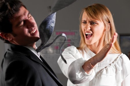 Angry businesswoman is slapping across the busines...