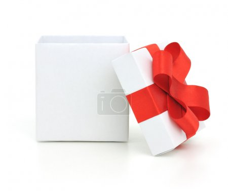 Photo for Open empty gift box and red bow. Isolated. - Royalty Free Image