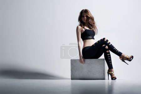 Photo for Young woman fashion. On wall background. - Royalty Free Image