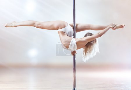 Photo for Young pole dance woman. Bright white colors. - Royalty Free Image