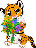 Cute little tiger cub holding a bouquet