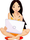 Young Asiatic woman sitting on cushion with laptop