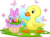 Velikonoční káčátko s košíkem vajec