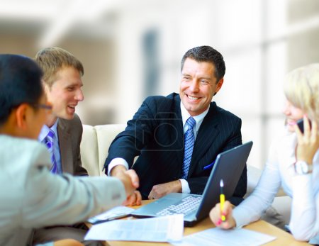 Business shaking hands, finishing up a meeting