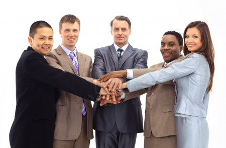 A diverse group of business workers with their hands together in form of te