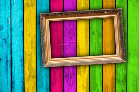 Photo for A blank vintage frame on a multicolored wood background - Royalty Free Image