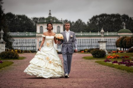 Photo for Portrait of newlyweds walking in moscow estate - Royalty Free Image