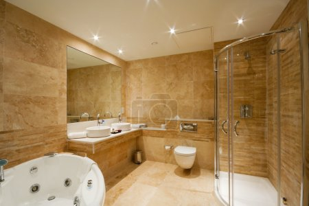 Photo for Modern Bathroom interior with marble tiles and mirror - Royalty Free Image
