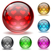 Glossy colorful globes with hearts inner spherical pattern