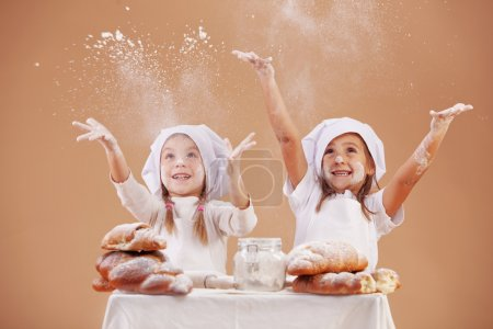 Photo for Little cute bakers studio shot - Royalty Free Image