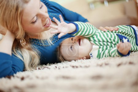 Photo for Mother with her baby at home - Royalty Free Image