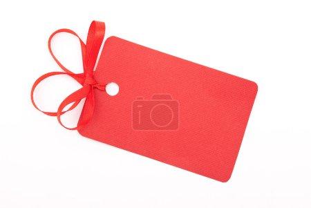 Photo pour Étiquette cadeau rouge avec arc - image libre de droit